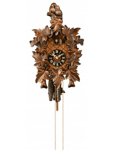 Cuckoo clock, with hand carved Bird and leaves