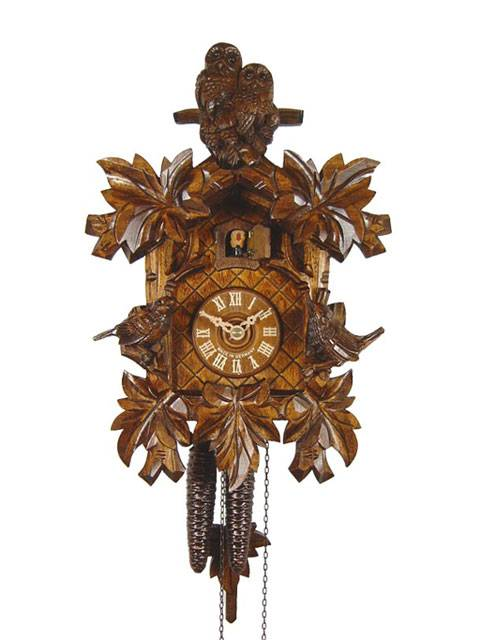 Cuckoo clock with a carved Owl and Sparrow