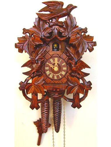 Cuckoo clock with deep carving