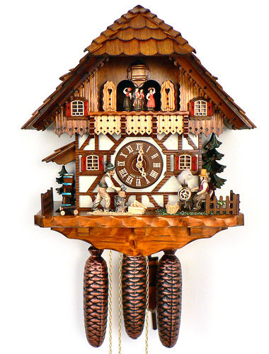 Cuckoo clock with wood chopper and weaving wife