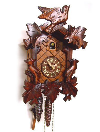 Cuckoo clock with carved headpiece