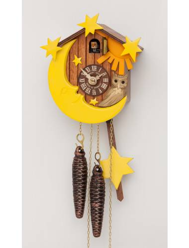 A small Chalet clock with sun and moon decoration